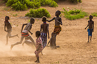 Dassanach tribe boys playing near their village, near Omorate, Omo Valley, Ethiopia.