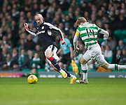 Dundee's James Vincent races away from Celtic's Stuart Armstrong - Celtic v Dundee in the Ladbrokes Scottish Premiership at Celtic Park, Glasgow. Photo: David Young<br /> <br />  - © David Young - www.davidyoungphoto.co.uk - email: davidyoungphoto@gmail.com