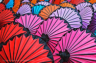 Pattern of newly assembled decorative umbrellas drying in sun, Umbrella Making Center, Bo Sang, near Chiang Mai, Thailand