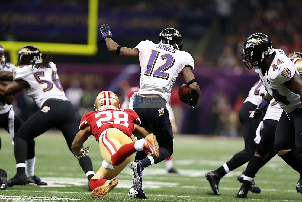 Jacoby Jones (12) of the Baltimore Ravens in action against the the San Francisco 49ers during the NFL Super Bowl XLVII football game in New Orleans on Feb. 3, 2013. The Ravens won the game, 34-31.  (Photo by Jed Jacobsohn)