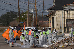 21December 05. New Orleans, Louisiana. Post Katrina aftermath.<br />  City contractors start thje long and arduous task of clearing the trash strewn streets of the  9th Ward long after the  flood from Hurricane Katrina subsided. <br /> Photo; ©Charlie Varley/varleypix.com