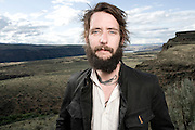 """Ben Bridwell of Band of Horses poses for a portrait backstage at the Sasquatch Music Festival on May 30th, 2010. Gear: Nikon D700, Nikon 35mm Lens, Speedotron Black Line 1205cx 22"""" Speedotron beauty dish with 30 degree grid for highlight."""