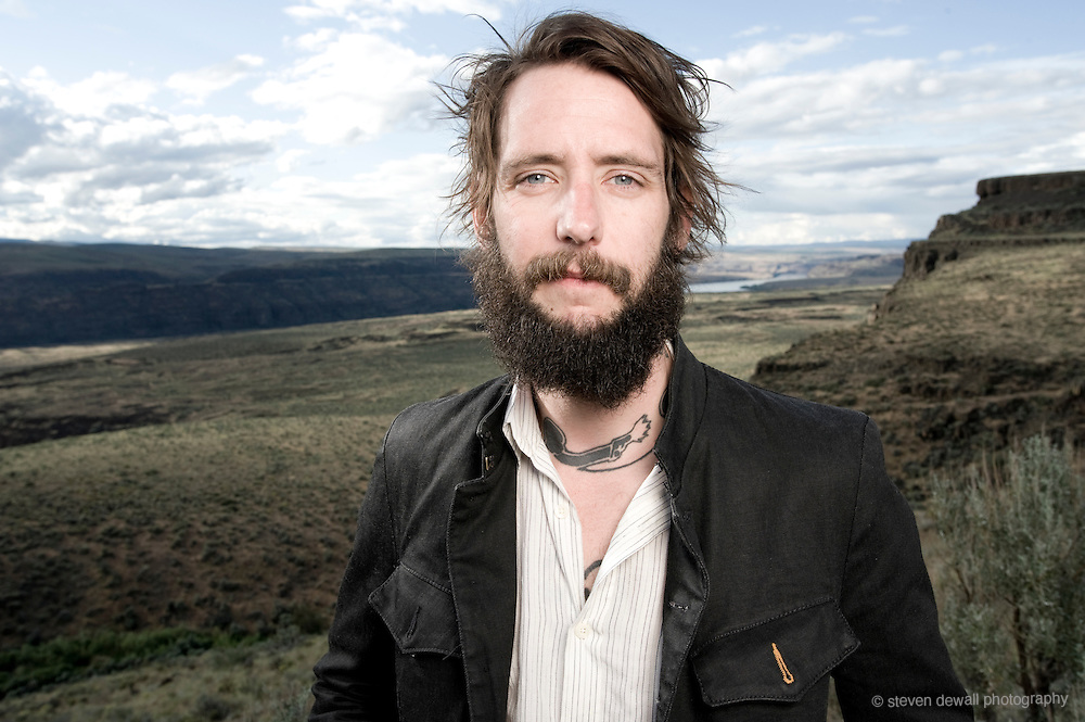 "Ben Bridwell of Band of Horses poses for a portrait backstage at the Sasquatch Music Festival on May 30th, 2010. Gear: Nikon D700, Nikon 35mm Lens, Speedotron Black Line 1205cx 22"" Speedotron beauty dish with 30 degree grid for highlight."