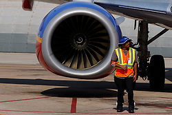 Workers stands in front of the CFM International CFM56 turbofan engine of a Southwest Airlines Boeing 737, San Diego International Airport (KSAN), San Diego, California, United States of America