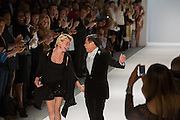 Zang Toi with Julie Macklowe at the end of his Spring 2013 show at Fashion Week in New York. Macklowe, investor, hedge fund manager and socialite,  was reportedly the muse for the collection.