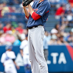 March 6, 2011; Port St. Lucie, FL, USA; Boston Red Sox pitcher Andrew Miller (30) during a spring training exhibition game against the New York Mets at Digital Domain Park.  Mandatory Credit: Derick E. Hingle
