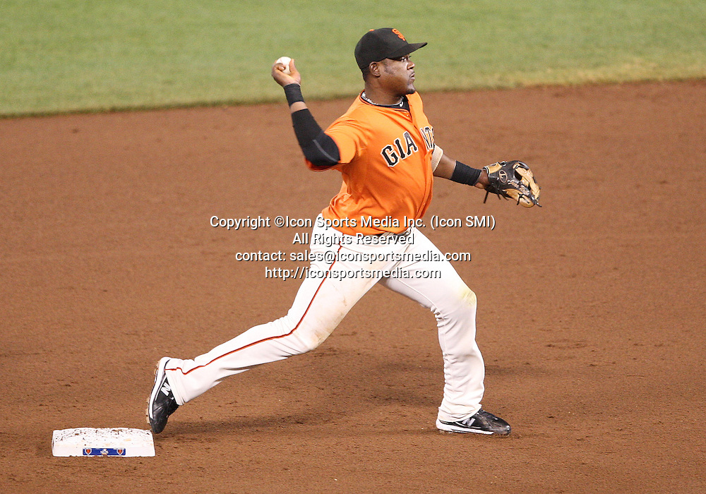 08 October 2010: San Francisco Giants shortstop Juan Uribe (5) turns a double play as the Giants lead the Braves 4-1 through seven innings in game 2 of the National League Division Series at AT&T Park in San Francisco, California ***FOR EDITORIAL USE ONLY****