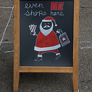 Blackboard Christmas  Humor<br /> &quot;evem HE shops here&quot;