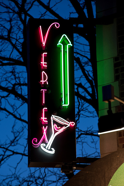 The arrow points the way to the Vertex Sky Bar, atop the Hotel Alex Johnson in Rapid City, South Dakota.