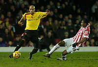 Photo: Leigh Quinnell.<br /> Watford v Stoke City. Coca Cola Championship.<br /> 14/01/2006. Watfords Marlon King is under presure from Stokes  Junior.