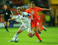 Fotball<br /> Euro 2004<br /> 18.06.2004<br /> Foto: SBI/Digitalsport<br /> NORWAY ONLY<br /> <br /> Nederland v Tsjekkia<br /> <br /> Pavel Nedved is tripped by Johnny Heitinga who was then shown the red card