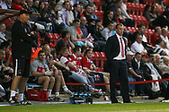 Picture by David Horn/Focus Images Ltd +44 7545 970036.21/08/2012.Gary Smith, Manager of Stevenage looks on during the npower League 1 match at the Matchroom Stadium, London. of Stevenage during the npower League 1 match at the Matchroom Stadium, London.