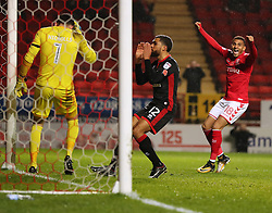 Milton Keynes Dons Scott Golbourne reacts after scoring an own goal during the Sky Bet League One match at The Valley, Charlton.