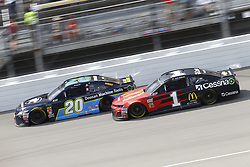 August 12, 2018 - Brooklyn, Michigan, United States of America - Erik Jones (20) and Jamie McMurray (1) battle for position during the Consumers Energy 400 at Michigan International Speedway in Brooklyn, Michigan. (Credit Image: © Chris Owens Asp Inc/ASP via ZUMA Wire)