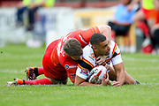 Bradford Bulls winger Omari Caro (18) is tackled during the Kingstone Press Championship match between Sheffield Eagles and Bradford Bulls at, The Beaumont Legal Stadium, Wakefield, United Kingdom on 3 September 2017. Photo by Simon Davies.