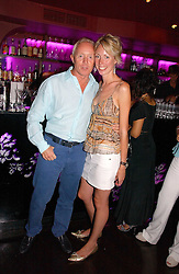 SIMON BREWER and REBECCA STEELS at the launch party for Uluvka Vodka's magnum bottle held t Bijois, South Kensington, London on 26th July 2006.<br /><br />NON EXCLUSIVE - WORLD RIGHTS