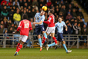 Coventry City defender Chris Stokes  wins the header  during the Sky Bet League 1 match between Coventry City and Walsall at the Ricoh Arena, Coventry, England on 12 January 2016. Photo by Simon Davies.