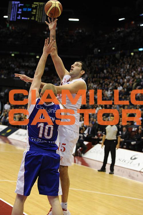 DESCRIZIONE : Milano Lega Basket A 2011-12  EA7 Emporio Armani Milano Bennet Cantu<br /> GIOCATORE : Ioannis Bourousis<br /> CATEGORIA : tiro<br /> SQUADRA : EA7 Emporio Armani Milano <br /> EVENTO : Campionato Lega A 2011-2012 <br /> GARA : EA7 Emporio Armani Milano Bennet Cantu<br /> DATA : 15/04/2012<br /> SPORT : Pallacanestro  <br /> AUTORE : Agenzia Ciamillo-Castoria/GiulioCiamillo<br /> Galleria : Lega Basket A 2011-2012  <br /> Fotonotizia : Milano Lega Basket A 2011-12 EA7 Emporio Armani Milano Bennet Cantu<br /> Predefinita :