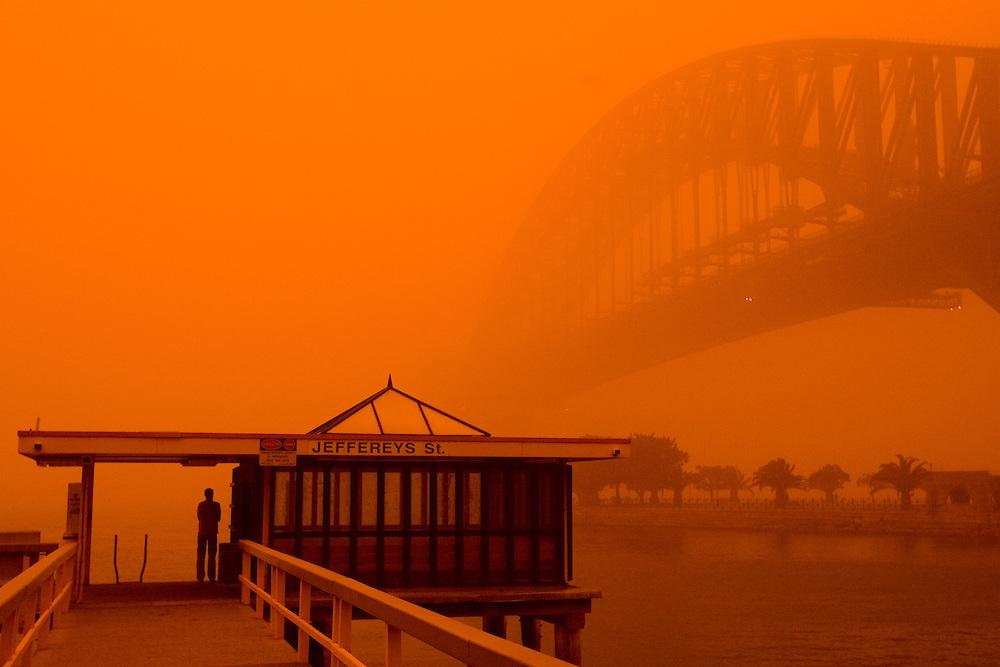 A red dust storm covers the Sydney Harbour Bridge.