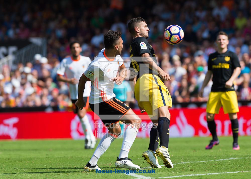 Munir El Haddadi of Valencia CF and Jorge Resurreccion Koke of Atletico Madrid during the La Liga match at Mestalla, Valencia<br /> Picture by Maria Jose Segovia/Focus Images Ltd +34 660052291<br /> 02/10/2016