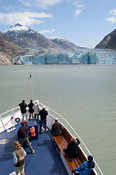 Alaska, Cruising the Southeast wilderness waterways on the Spirit of Discovery.  Endicott Arm and Dawes Glacier, scenery, glacier and cruise ship..Photo #: alaska10400 .Photo copyright Lee Foster, 510/549-2202, lee@fostertravel.com, www.fostertravel.com..