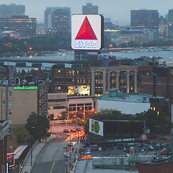 Boston skyline aerial photo with the Citgo sign, East Cambridge skyline, Fenway Park, Kenmore Square, Harvard Bridge, and the Charles River. Boston Massachusetts is a major city in the Eastern United States. Copyright ⓒ Paul Velgos with All Rights Reserved.