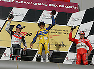 From left to right, American Nicky Hayden finishes in second place, Italy's Valentino Rossi in his 1st place, and Spain's Sete Gibernau celebrates his 3rd place finish in the Commercial Bank Grand Prix of Qatar, MOTO GP class, Losail International Circuit, 8 April 2006