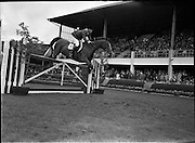 "09/08/1962<br /> 08/09/1962<br /> 09 August 1961<br /> RDS Horse Show, Ballsbridge Dublin, Thursday. <br /> Picture show ""Sin Jon"" of U.S.A. ridden by William C. Steinkraus."