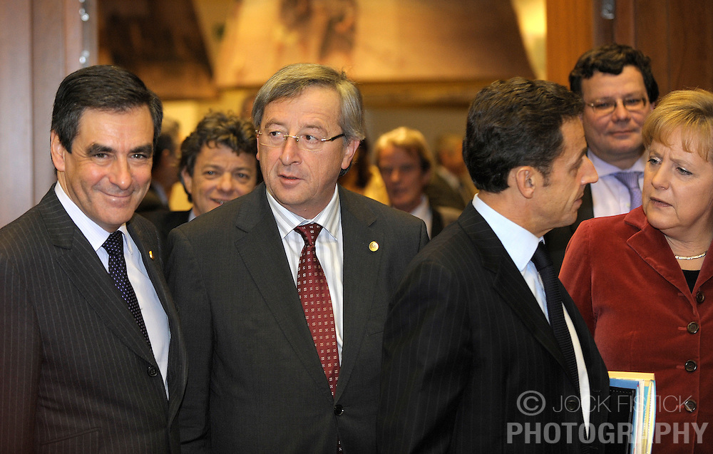 Francois Fillon, France's prime minister, left, Jean-Claude Juncker, Luxembourg's prime minister, center left, Nicolas Sarkozy, France's president, center right, and Angela Merkel, Germany's chancellor, arrive on the first day of the European Summit, in Brussels, Belgium on Thursday, Dec. 11, 2008. (Photo © Jock Fistick)
