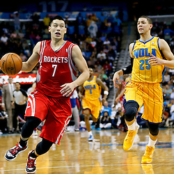 Jan 25, 2013; New Orleans, LA, USA; Houston Rockets point guard Jeremy Lin (7) drives past New Orleans Hornets shooting guard Austin Rivers (25) during the second half of a game at the New Orleans Arena. The Rockets defeated the Hornets 100-82. Mandatory Credit: Derick E. Hingle-USA TODAY Sports