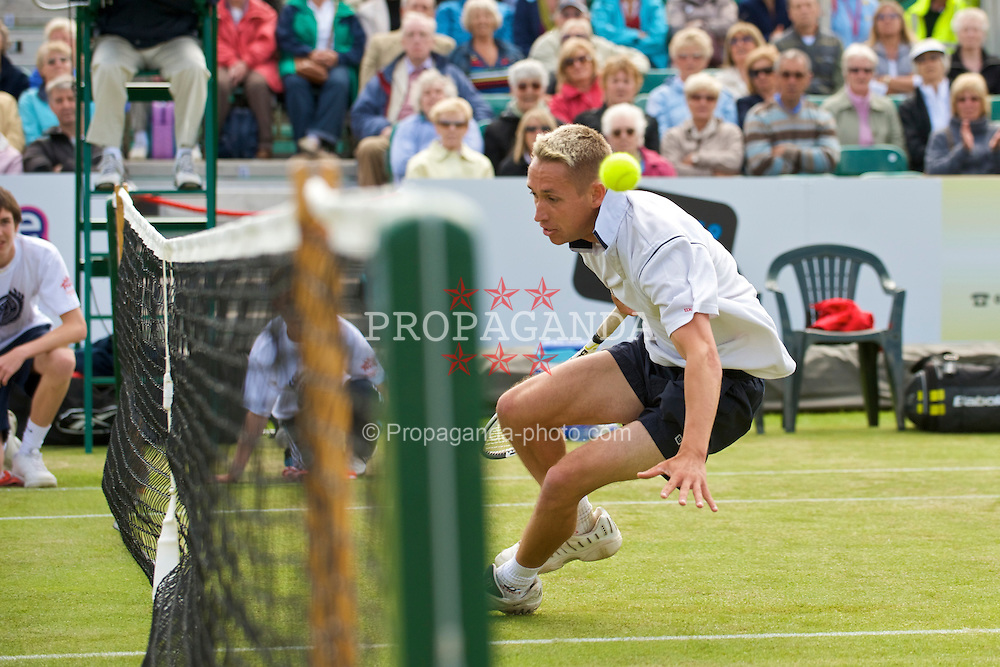 LIVERPOOL, ENGLAND - Friday, June 19, 2009: Simon Roberts (GBR) crashes into the net as he chases a drop shot during Day Three of the Tradition ICAP Liverpool International Tennis Tournament 2009 at Calderstones Park. (Pic by David Rawcliffe/Propaganda)