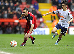 Bristol City's Sam Baldock battles for the ball with Bolton Wanderers' Lee Chung-Yong - Photo mandatory by-line: Joe Meredith/JMP - Tel: Mobile: 07966 386802 13/04/2013 - SPORT - FOOTBALL - Ashton Gate - Bristol - Bristol City V Bolton Wanderers - Npower Championship