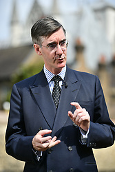 © Licensed to London News Pictures. 09/07/2018. London, UK. Jacob Rees-Mogg is seen talking to reporters near Parliament. Brexit Secretary DAVID DAVIS has resigned over Prime Minister Theresa May's Brexit Plan. Mr Davis was appointed to the post in 2016 and was responsible for negotiating the UK's EU withdrawal. Photo credit: Ben Cawthra/LNP