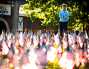 Aida Garcia, a UK student, paused to watch as  members of the UK  Army and Air Force ROTC held vigil for the victims of 9/11 reading the names of the victims among the flags in the front lawn of the Administration building  on Tuesday September 11, 2012 in Lexington, Ky.  Photo by Mark Cornelison | Staff