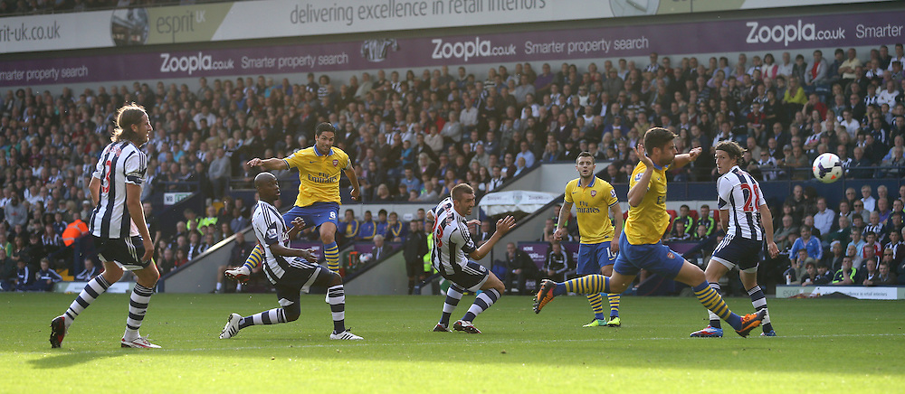 6th October 2013 - Barclays Premier League - West Bromwich Albion v Arsenal - Mikel Arteta of Arsenal (3L) shoots through a field of players - Photo: Simon Stacpoole / Offside.