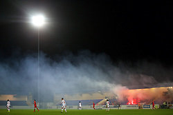 CHESTER, ENGLAND - Friday, October 23, 2015: Smoke billows across the pitch as Benfica supporters let off flares and smoke bombs during the Premier League International Cup match against Liverpool at the Deva Stadium. (Pic by David Rawcliffe/Propaganda)