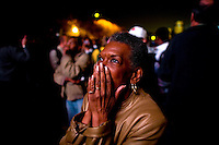 Teddi Beasley, of Chicago Ill watches poll numbers being announced as supporters take to Chicago's Grant Park for the election night results for the presidential race between Sen. Barak Obama (D-IL) and Sen. John McCain (R-AZ) Tuesday Nov. 4, 2008 Chicago IL.