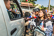 22 DECEMBER 2013 - BANGKOK, THAILAND: Anti-government protestors block a van full of Thai riot police trying to move to the home of Prime Minister Yingluck Shinawatra. The police were prevented from going to the house. Hundreds of thousands of Thais gathered in Bangkok Sunday in a series of protests against the caretaker government of Yingluck Shinawatra. The protests are a continuation of protests that started in early November and have caused the dissolution of the Pheu Thai led government of Yingluck Shinawatra. Protestors congregated at home of Yingluck and launched a series of motorcades that effectively gridlocked the city. Yingluck was not home when protestors picketed her home.     PHOTO BY JACK KURTZ