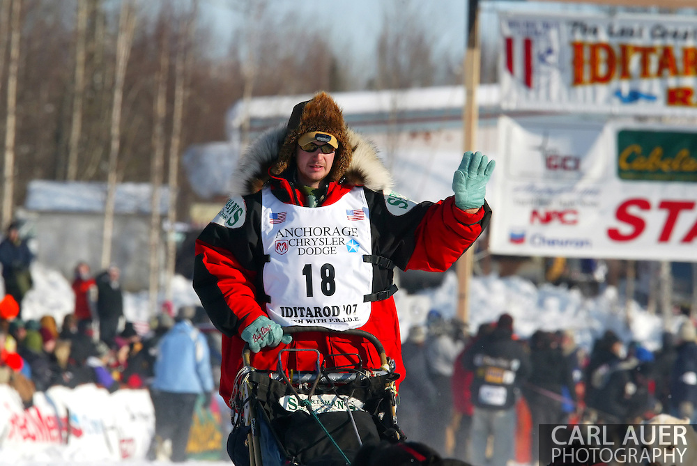 3/4/2007:  Willow, Alaska -  Veteran Ray Redington, Jr of Two Rivers, AK waves to the fans as he starts down the same trail run by his Father and Grandfather in hopes that he too can be the next Redington to cross the finish line first in Nome as he starts out on the running of the 35th Iditarod Sled Dog Race