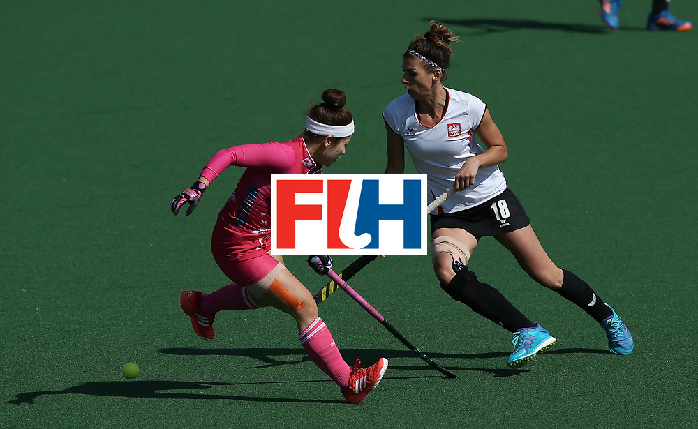 JOHANNESBURG, SOUTH AFRICA - JULY 14: Natalia Wisniewska of Poland and Hazuki Nagai of Japan battle for possession during day 4 of the FIH Hockey World League Semi Finals Pool B match between Poland and Japan at Wits University on July 14, 2017 in Johannesburg, South Africa. (Photo by Jan Kruger/Getty Images for FIH)