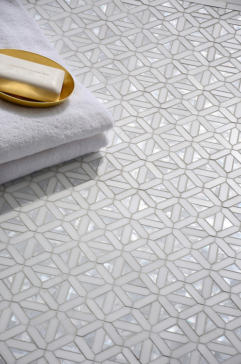 Joie, a handmade mosaic shown in polished Dolomite and Shell, is part of the Aurora® collection by New Ravenna.