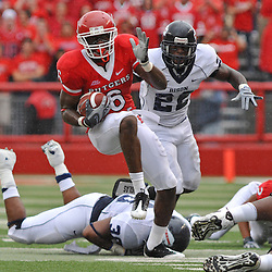 Sep 12, 2009; Piscataway, NJ, USA; Rutgers wide receiver Mohamed Sanu (6) evades tacklers during the first half of Rutgers' 45-7 victory over Howard in NCAA College Football at Rutgers Stadium.