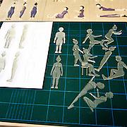 Produzione di pannelli di resina nel laboratorio dell'Istituto dei Ciechi a Milano, seguendo i criteri dell'alfabeto Braille. Con questi pannelli i ciechi possono leggere e conoscere i monumenti attraverso il tatto..Nella foto: sagome in legno e resina che saranno utilizzate per i pannelli di plastica. Per produzioni numerose si utilizzano le figure in resina per evitare che quelle in legno si rovinino...Production of resin panels in the laboratory of the Institute of the Blind people to Milan, following the criteria of the Braille alphabet. With these panels the blind people can read and know monuments through the tact..In the photo: designs to the computer of the figures that will be reproduced on wood..Photo: silhouettes in wood and resin that will be used for plastic panels. For many products you use the figures in resin to prevent the wood are ruined.