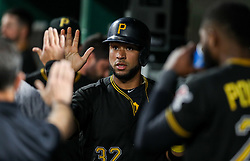 Jun 15, 2018; Pittsburgh, PA, USA; Pittsburgh Pirates catcher Elias Diaz (32) celebrates with teammates after scoring during the sixth inning against the Cincinnati Reds at PNC Park. Mandatory Credit: Ben Queen-USA TODAY Sports