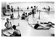 Young aspiring ballerinas warming up during a summer workshop at the Israeli Ballet Company. Tel Aviv, Israel, 2007