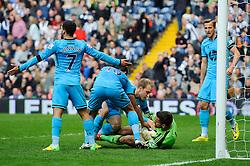 Goalscorer Christian Eriksen (DEN) of Tottenham Hotspur tries to wrestle the ball off Ben Foster (ENG) of West Brom after scoring  - Photo mandatory by-line: Rogan Thomson/JMP - 07966 386802 - 12/04/2014 - SPORT - FOOTBALL - The Hawthorns Stadium - West Bromwich Albion v Tottenham Hotspur - Barclays Premier League.