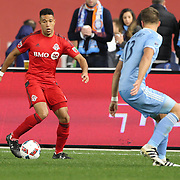 NEW YORK, NEW YORK - November 06: Justin Morrow #2 of Toronto FC is challenged by Frederic Brillant #13 of New York City FC during the NYCFC Vs Toronto FC MLS playoff game at Yankee Stadium on November 06, 2016 in New York City. (Photo by Tim Clayton/Corbis via Getty Images)