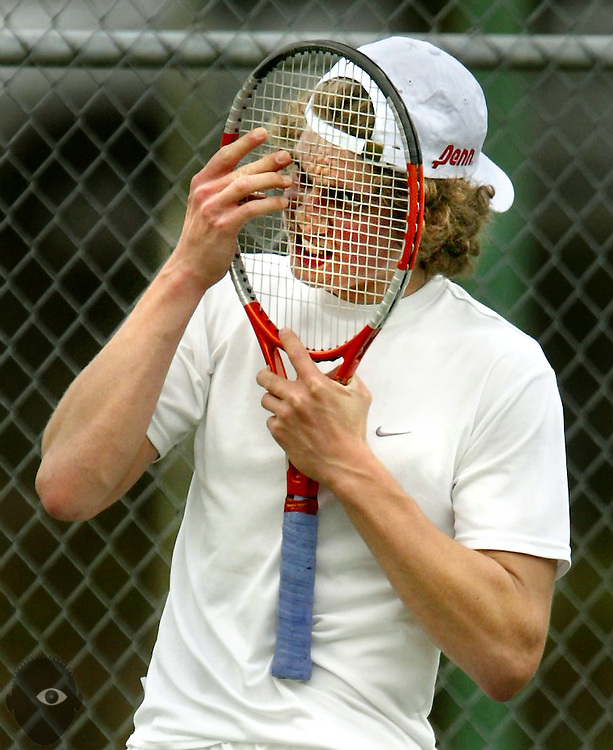 Men's singles runner-up Willy Nolan of Grant smashes his racket into his face in frustration. The PIL tennis championships were held at the Portland Tennis Center...