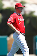 ANAHEIM - APRIL 10:  First baseman Mark Trumbo #44 of the Los Angeles Angels of Anaheim stretches before the game between the Toronto Blue Jays and the Los Angeles Angels of Anaheim at Angel Stadium in Anaheim, California on Sunday April 10, 2011. The Angels won the game 3-1. (Photo by Paul Spinelli/MLB Photos via Getty Images) *** Local Caption *** Mark Trumbo