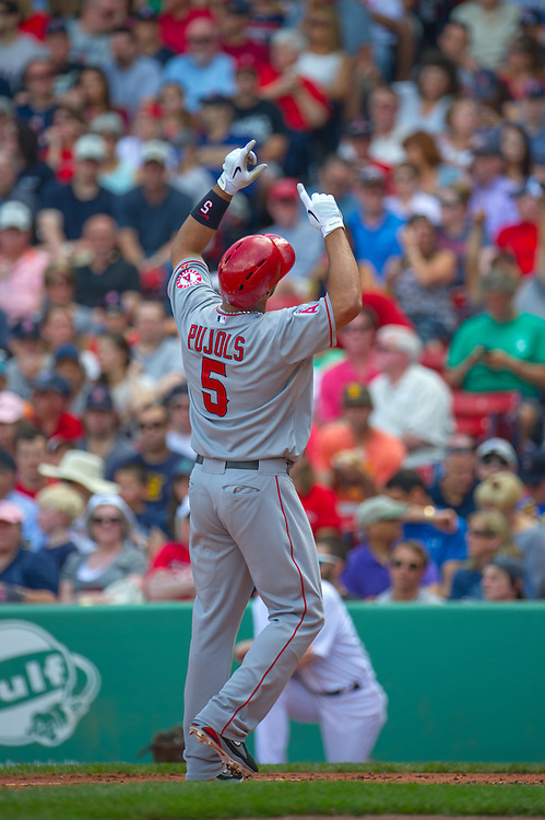 BOSTON, MA - JUNE 09: Albert Pujols #5 of the Los Angeles Angels gestures after scoring during the game against the Boston Red Sox at Fenway Park in Boston, Massachusetts on June 9, 2013. (Photo by Rob Tringali) *** Local Caption *** Albert Pujols